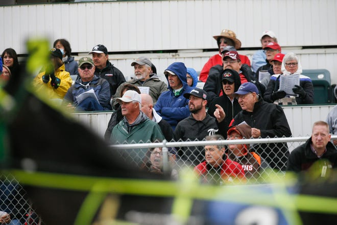 Spectators watch a race at the Little Brown Jug on Sept. 23. Despite the pandemic and cold, damp weather, spectators showed up in droves to watch horse races as part of Little Brown Jug Day at the Delaware County Fairgrounds.