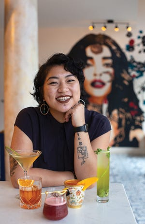 Genevieve Johnson behind the bar at Rooh in the Short North