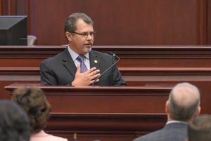 State Rep. Tom Leek, R-Ormond Beach, speaks from the well of the Florida House of Representatives on Tuesday. Leek chairs the House Redistricting Committee. He pledged to follow the state constitution which has fair redistricting provisions.