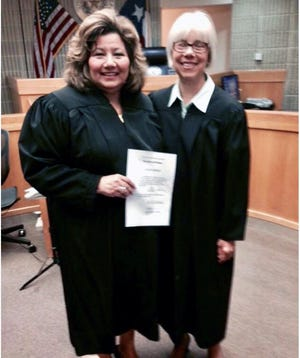 Grayson County's two female judges, JP Rita Noel, holding the paper, and County Court-at-Law #2 Judge Carol Siebman (courtesy photo).