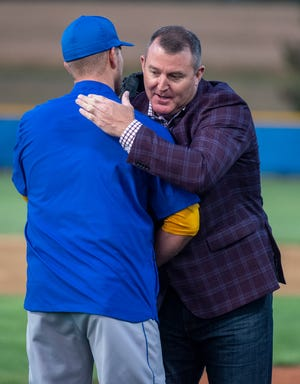Jim Thome hugs ICC assistant coach and fellow Limestone High School alum Ryan Camp after throwing him the first pitch before a scrimmage on the newly-dedicated Thome Fields on Wednesday, Sept. 22, 2021 at Illinois Central College.
