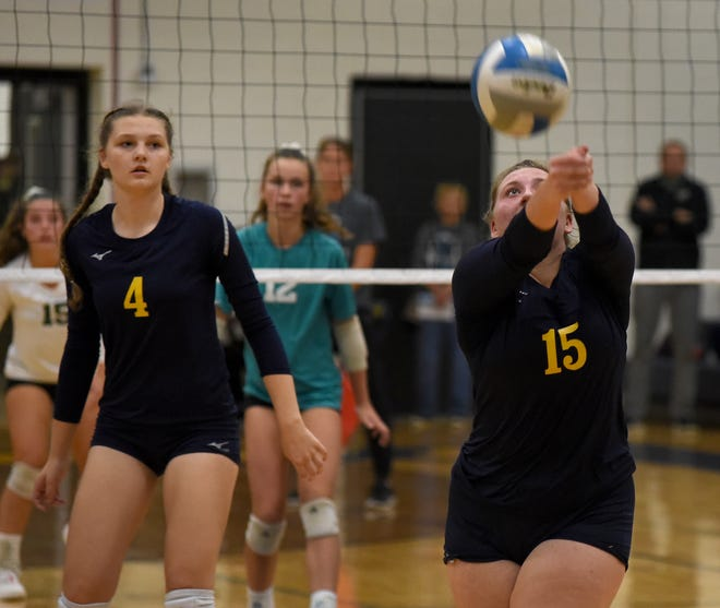 Avery Palmer of Airport bumps the ball with teammate Kali Wickenheiser looking on during a match earlier this season. The Jets beat Riverview in three sets Wednesday in the semifinals of the Huron League Tournament.