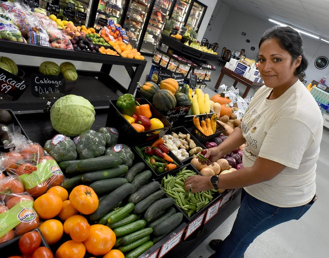 Sonya Hudson, manager of the Village Market in Monroe, is very appreciative of the produce that has been donated by the Monroe County Community College farm. The market seeks to provide access to food in an area that has been called a food desert.