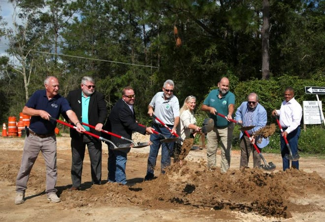 Officials from Walton County, DeFuniak Springs and the Walton County Economic Development Alliance broke ground Tuesday on a $4.7 million water and sewer improvement project along U.S. Highway 331 aimed at boosting economic development in the DeFuniak Springs and Freeport areas.