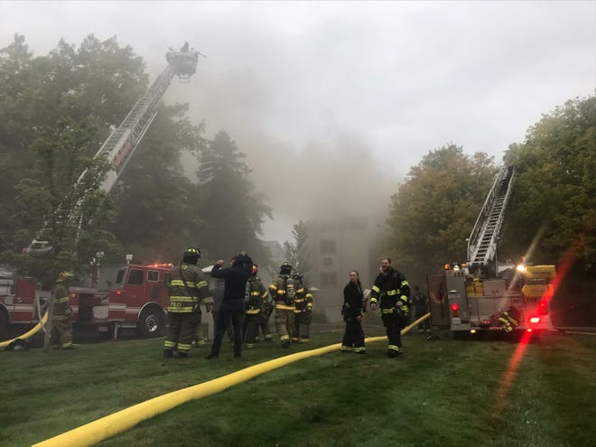 First responders on the scene of a condo fire in Charlevoix, located at the Captain's Watch condos on Park Avenue, on Thursday morning.