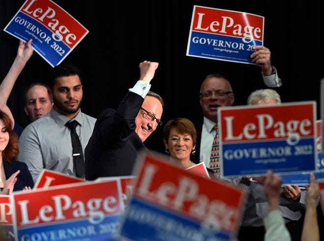 Former Gov. Paul LePage pumps his fist as he walks off the stage at the Augusta Civic Center in Augusta, Maine, Wednesday, Sept. 22, 2021. LePage formally kicked off his campaign for a third term in front of more than a thousand noisy supporters at an indoor arena in the capital city.