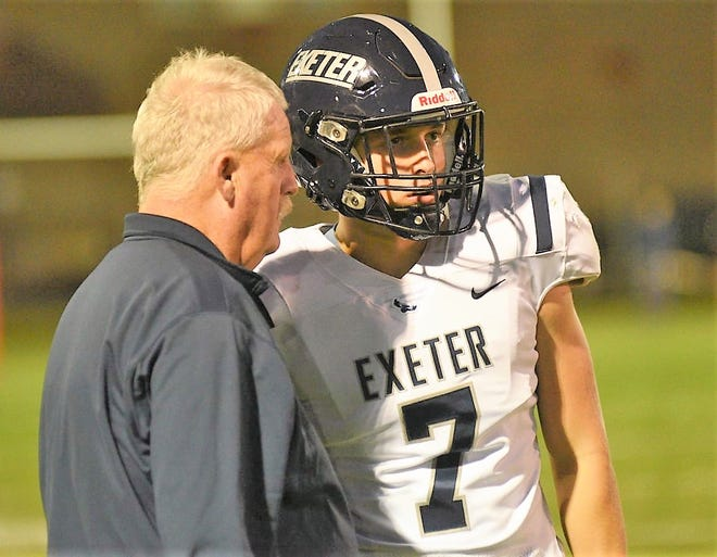 Exeter High School head football coach Bill Ball talks to quarterback Aidan McGinley during a break in the Blue Hawks' 35-0 win over Spaulding in Week 2 this season.