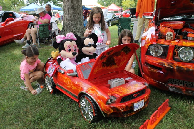 """Sisters from left to right, Lilly, Emma, and Abby Deaders check out the child's power wheel at the 20th annual Southern Knights Cruisers Veterans Car and Bike Show at Richard Bland College in Aug. of 2019. """"Baby GT Fire"""" was designed to show alongside """"GT Fire"""" Mustang owned by Keith Williams of Sandston."""