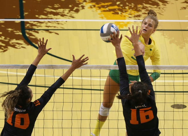 Oregon's Brooke Nuneviller, right, goes up for a shot in a home win against Oregon State at Matthew Knight Arena earlier this season.
