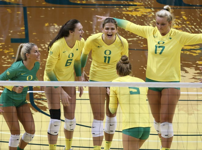 The Oregon volleyball team celebrates a point in its Pac-12-opening win against Oregon State at Matthew Knight Arena.