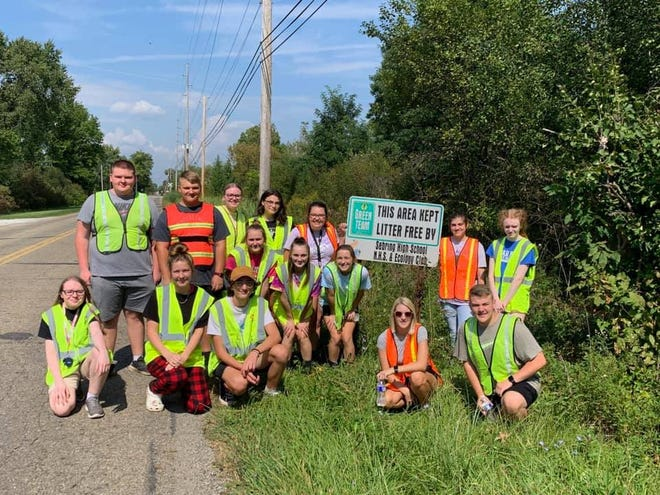 """Members of Sebring McKinley High School Ecology Club cleaned up a portion of Johnson Road as part of the """"Adopt-a-Highway"""" program."""