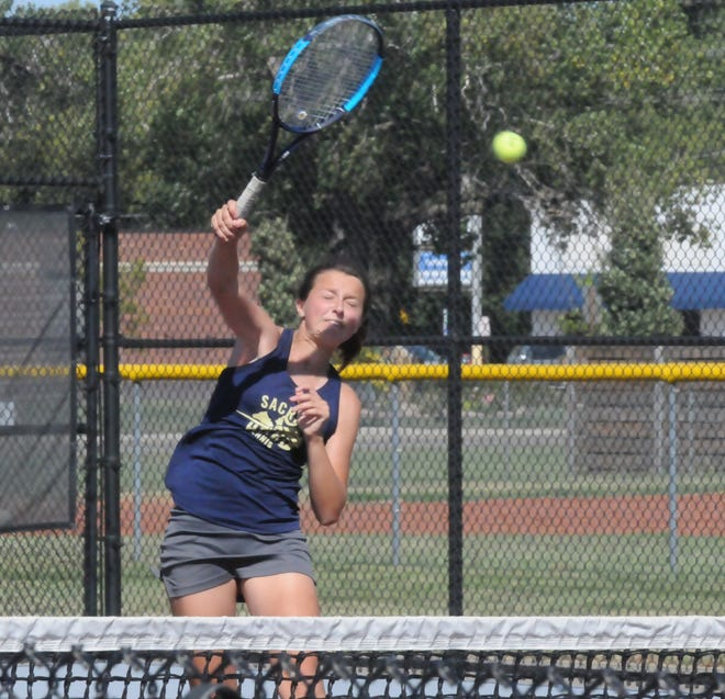 Sacred Heart's Katie Weiss swings the ball over the net during Thursday's Salina South Invitational at the Salina Central tennis courts.