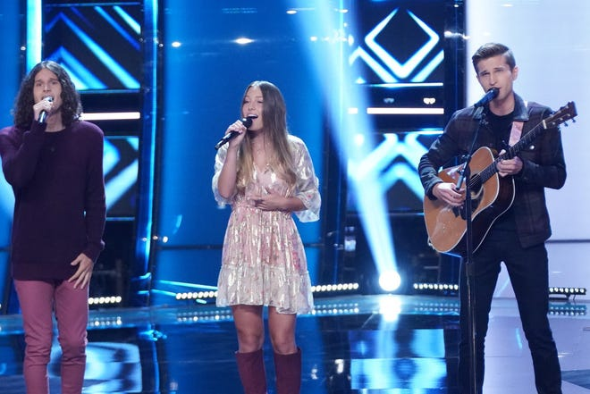 """The siblings vocal group Girl Named Tom — Joshua, left, Bekah and Caleb Liechty — perform on the """"blind audition"""" episode of """"The Voice"""" on NBC."""