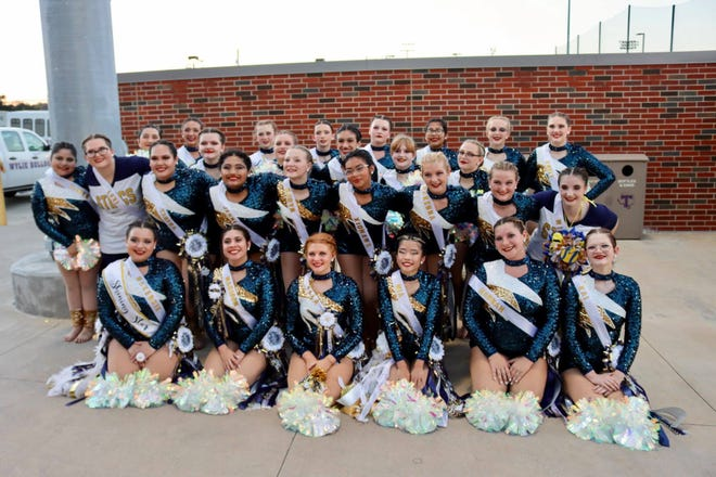 The Stephenville High School Stings take a break before performing at the Homecoming game on Sept. 17.