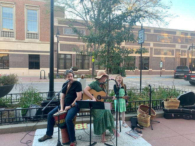 Jason, Jennifer, and Eden Barkmeier, 8, of Little E and the A' Jays perform on Main Street at the Wine Walk on Wednesday evening.