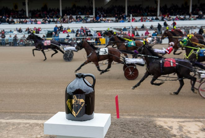 Up to 40,000 people showed up to Thursday's races that were part of Little Brown Jug Day at the Delaware County Fairgrounds.