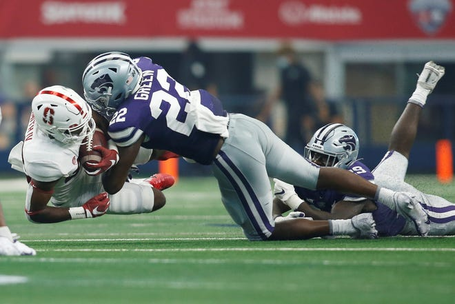 Kansas State linebacker Daniel Green tackles Stanford running back E.J. Smith (22) during the Sept. 4 season opener in Arlington, Texas.