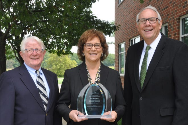 Jim Ryan, Tracey Huston and Craig Weidemann, (from left) pose with the 2021 Ryan, Moser, Reilly Excellence in Community Engagement Institutional Leadership Award.