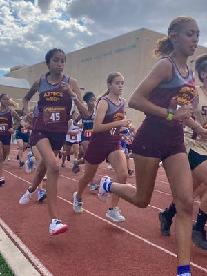 Barstow's Angelina Vasquez, right, leads the pack of runners at the first Desert Sky League meet of the season at Victor Valley High School on Sept. 23, 2021.