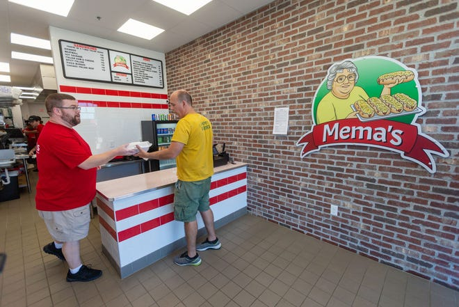 Chad Cline helps a customer at Mema's Italian Grinders in Grimes, Thursday, Sept. 23, 2021.