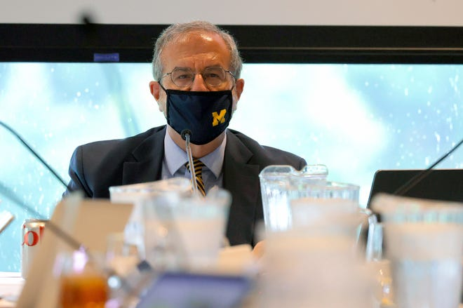 University of Michigan President Mark Schlissel addresses the Board of Regents inside the Richard L. Postma Family Clubhouse at the University of Michigan golf course in Ann Arbor on Sept. 23, 2021.