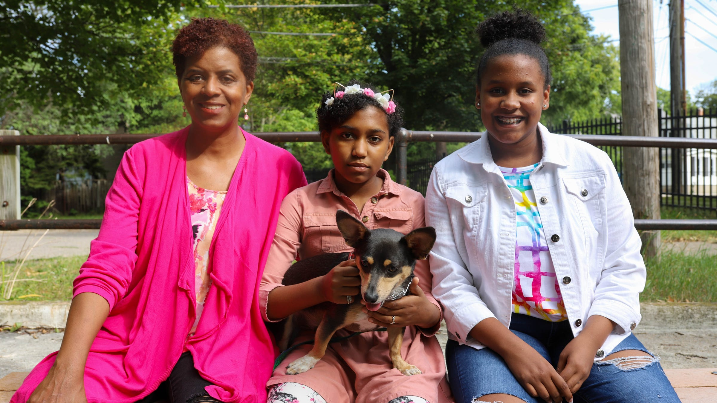 Charlotte Matthews with her daughters Madison Matthews and Chloe Matthews along with their family dog Kynng Matthews at Moores Park on September 3, 2021. Madison has Sickle Cell Disease and uses CBD and THC products to treat her symptoms.