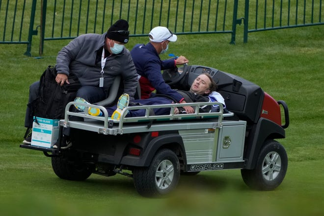 Actor Tom Felton is helped after collapsing on the 18th hole during a practice day at the Ryder Cup at the Whistling Straits Golf Course Thursday, Sept. 23, 2021, in Sheboygan, Wis.