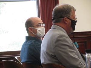 U.S. Air Force Captain David Scott Coon, left, sits with defense attorney Carl Jensen at Coon's sentencing hearing on Sept. 23, 2021.