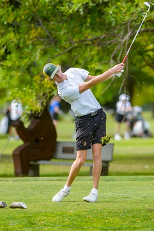 CMR's Eli Groshelle tees off on the par 3, 17th hole during the Eastern AA golf tournament at Eagle Falls Golf Course on Thursday.