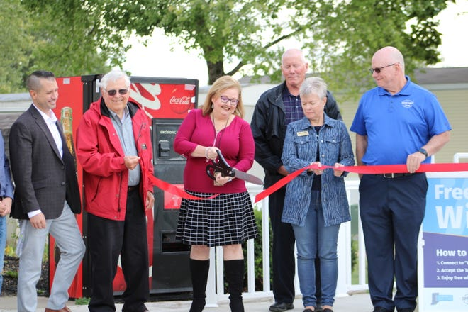 Tippecanoe County Commissioners held a ribbon-cutting ceremony Sept. 23, 2021, at Point West Mobile Home Community to officially open three free public hot spots across the county. Devin Arms, director of technology for Tippecanoe School corporation, left, joined Larry Carlson, Tipmont director, Loralie Swan, English language teacher at Burnett Creek Elementary School, Tippecanoe County commissioners Dave Byers, Kathy Vernon and Tracy Brown