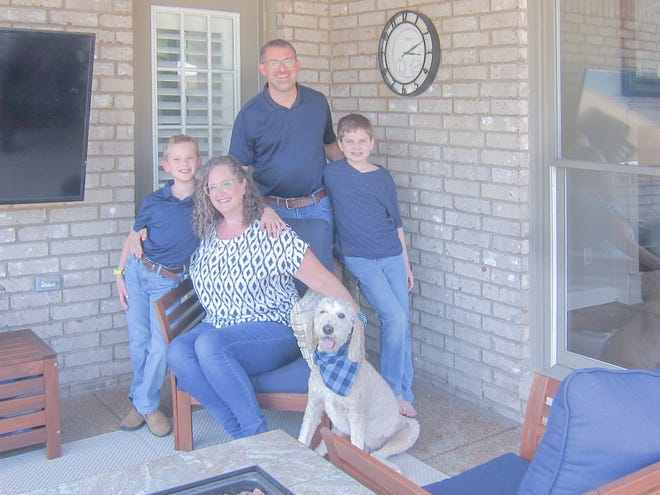 Denise and Gene Mangiante, and their sons Mikey (left), Will and canine companion Teddy love their new home.