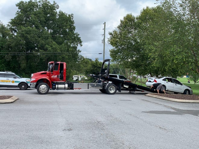A toe truck service responds to a car involved in a Tuesday (Sept.  21, 2021) fatal car fire.