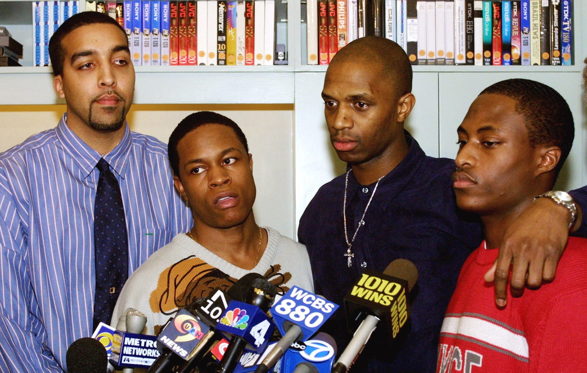 Danny Reyes, left, Keshon Moore, second left, Jarmaine Grant, third left, and Rayshawn Brown speak to the media at the end of a news conference Friday, Feb. 2, 2001, in New York. The state of New Jersey agreed to pay $12.9 million to the four who were victims of a 1998 police shooting on the New Jersey Turnpike that caused a national furor over racial profiling.