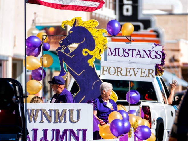 A Western New Mexico University Homecoming Parade float carries Mustang alumni through downtown Silver City in a past parade. The 2021 WNMU Homecoming celebrations began Thursday and run through Saturday night.