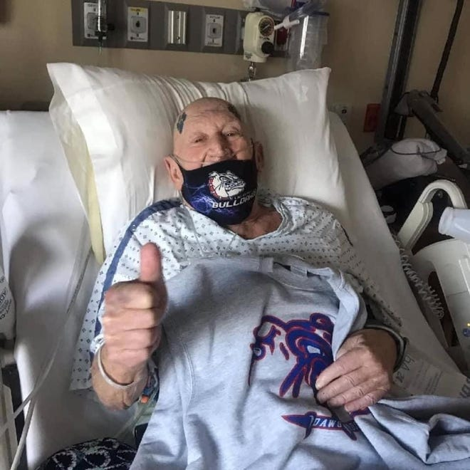 """Las Cruces High School """"Superfan"""" Jessy Vaughn gives a thumbs-up at Rehabilitation Hospital of Southern New Mexico Monday, Sept. 20, 2021. Vaughn suffered a compound fracture in his arm when he fell during the Las Cruces-Mayfield football game Friday night."""