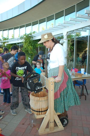 The Real Night at the Museum event planned for Saturday, Sept. 25 at the Farmington Museum at Gateway Park features a variety of historic activities, including apple pressing.