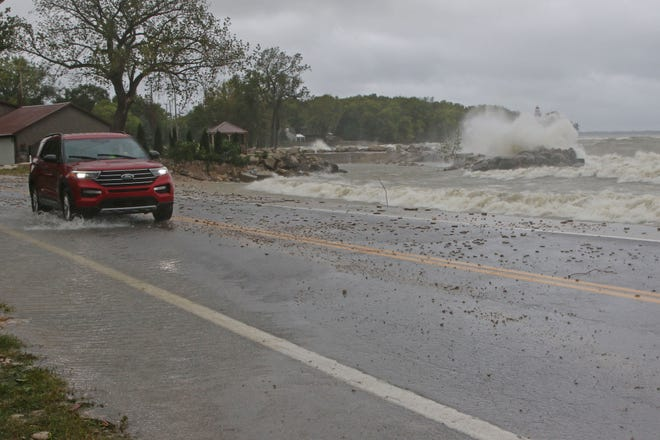 Strong northerly winds kicked up waves on Lake Erie Wednesday, pushing water and rocks onto Ohio 163 in Marblehead.
