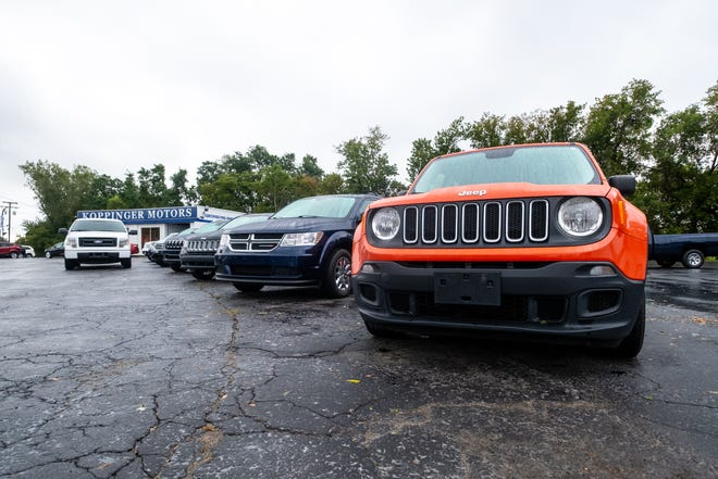 Used cars are parked on the lot at Koppinger Motors Thursday, Sept. 23, 2021, in Fort Gratiot. A semiconductor shortage is straining the global supply of new cars, which also affects used car inventory.