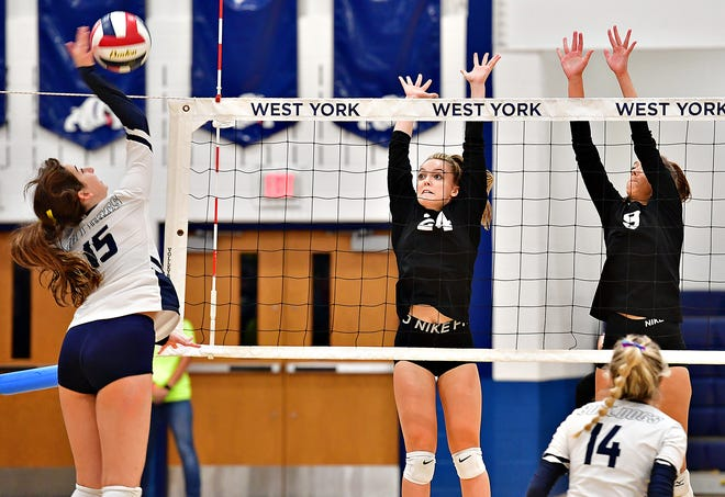 From left, West York's Leah Bazzle hits the ball across the net while York Suburban's Amanda Sargen and Eliana Rodgers defend during girls' volleyball action at West York Area High School in West Manchester Township, Wednesday, Sept. 22, 2021. York Suburban would win the match 3-0. Dawn J. Sagert photo
