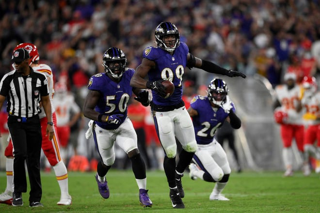 Baltimore Ravens linebacker Odafe Oweh (99) celebrates his fumble recovery in the second half of an NFL football game against the Kansas City Chiefs, Sunday, Sept. 19, 2021, in Baltimore. Also seen is linebacker Justin Houston (50). (AP Photo/Nick Wass)