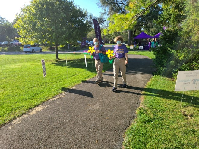 Walkers participate in the Walk to End Alzheimer's on Sept. 18 at Glen Miller Park's golf course.