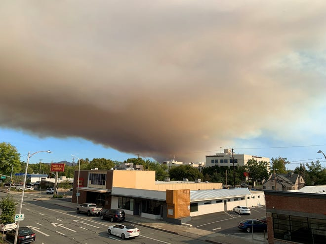 Smoke from the Fawn Fire rises above downtown Redding on Thursday, Sept. 23, 2021.