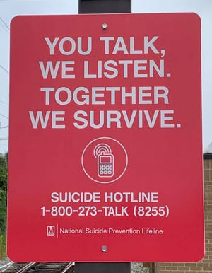 A sign at the end of the New Carrollton Metro Station shows the number for  the National Suicide Prevention Lifeline.