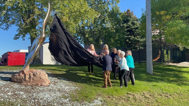 Board members of the Compassion Project unveil the Compassion statue, honoring Sioux Falls resident Fern Chamberlain, on Thursday, Sept. 23, 2021.