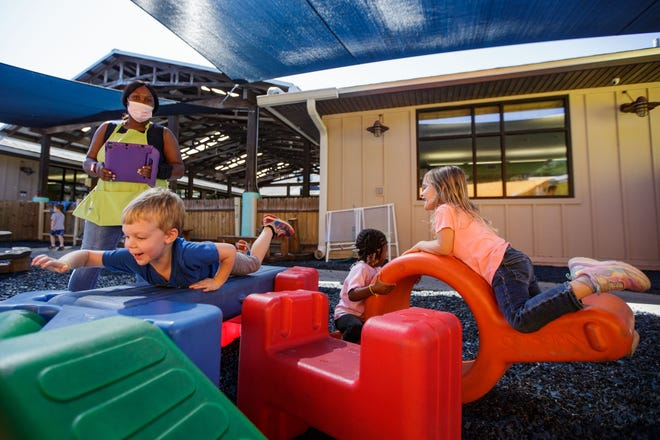 Children who attend daycare at The Learning Pavilion play outside as their teacher Elizabeth Kirby watches them have fun Thursday, Sept. 23, 2021.