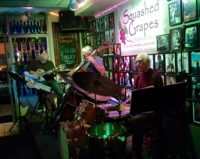 Colin Bailey, right, playing drums at the Squashed Grapes winery and jazz house in Ventura with the Colin Bailey Trio.