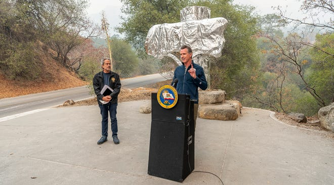California Gov. Gavin Newsom speaks to media Thursday, September 23, 2021 in Sequoia National Park before signing a $15 billion climate package into law that will help bolster the state's response to climate change. State Assembly Member Richard Bloom, (D-Santa Monica) is beside him.