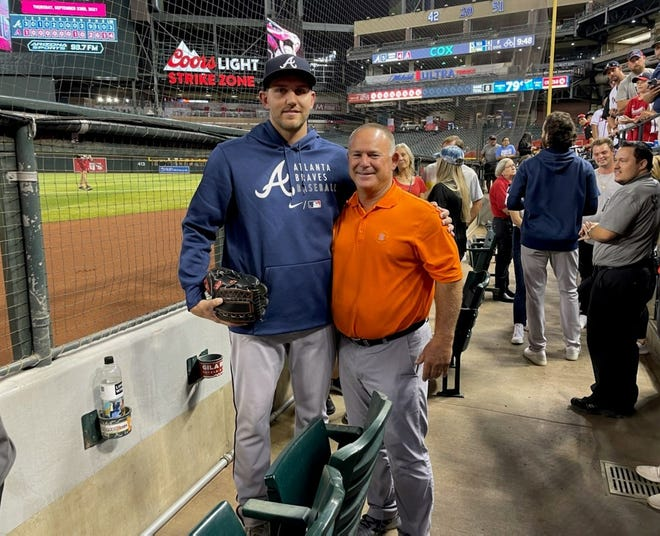 Atlanta Braves pitcher Dylan Lee poses for a photo with College of the Sequoias' baseball coach Jody Allen on Wednesday in Arizona. Lee, a former Dinuba and COS standout, was promoted to the majors this week.