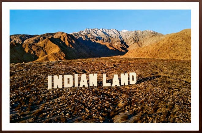 Nicholas Galanin installed 45-foot-high white letters spelling INDIAN LAND in the Southern California desert. Galanin's photograph of these words, a smackdown of the Hollywood sign two hours away, is now at the Forge Project in Ancram, New York.