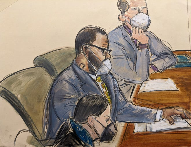 In this courtroom sketch, R. Kelly, center, sits with his attorneys Thomas Farinella, top, and Nicole Blank Becker during the first day of his defense in his sex-trafficking case on Sept. 20, 2021, in New York.